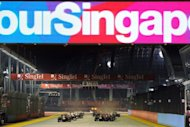 Formula One drivers are seen powering their cars at the start of Formula One's Singapore Grand Prix night race, in September 2011. Formula One hopes to push ahead with its $2.5 billion listing Singapore later this year, a source close to the deal said Thursday, as global financial markets are buffetted by economic uncertainty