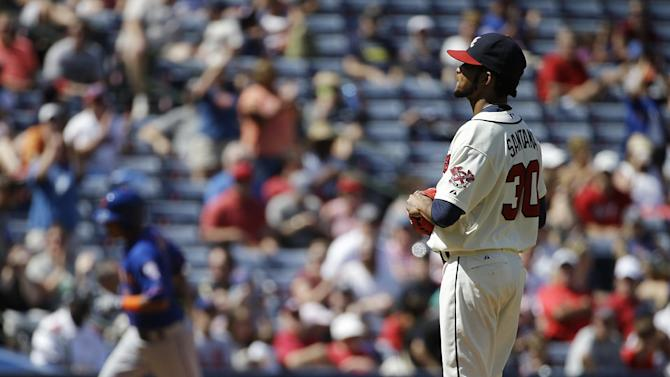 Atlanta Braves starting pitcher Ervin Santana, right, stands on the mound after giving up a home run to New York Mets' Ruben Tejada, left, in the fourth inning of a baseball game, Sunday, Sept. 21, 2014, in Atlanta. (AP Photo/David Goldman)