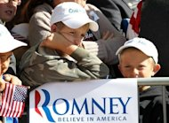 "Children look on during a campaign rally for Republican presidential candidate Mitt Romney at Alice Pleasant Park on May 29, in Craig, Colorado. Romney clinched his Republican party's White House nomination by winning its Texas primary, vowing to get America ""back on the path to prosperity"" by defeating Barack Obama in November"
