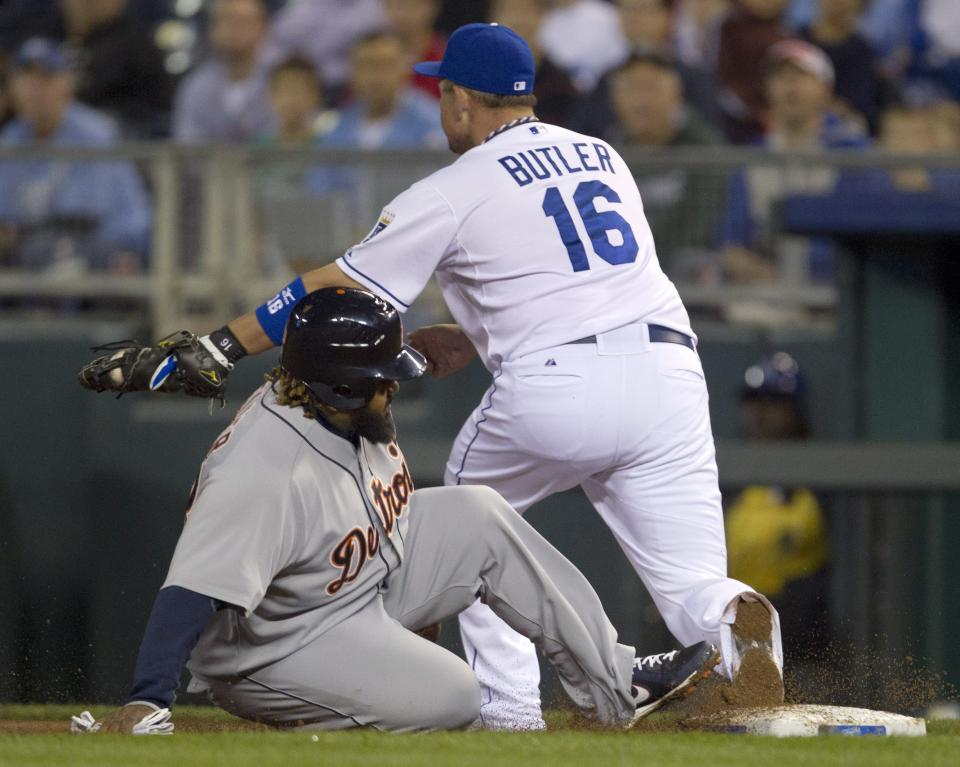 Detroit Tigers' Prince Fielder is doubled up off first base by Kansas City Royals first baseman Billy Butler, after Delmon Young popped out during the third inning of a baseball game at Kauffman Stadium in Kansas City, Mo., Tuesday, Oct. 2, 2012. (AP Photo/Orlin Wagner)