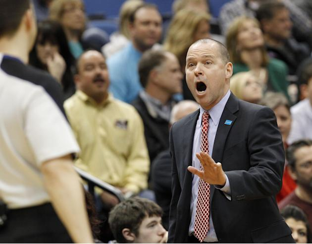 Sacramento Kings head coach Michael Malone, right, disagrees with referee Kane Fitzgerald during the fourth quarter of an NBA basketball game against the Minnesota Timberwolves in Minneapolis, Sunday,