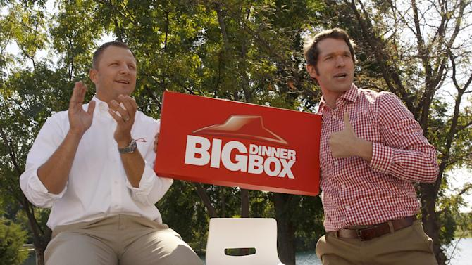 Doug Terfehr, Director of Public Relations and Marketing for Pizza Hut, and Scott Morehead, campaign manager for the Pizza Party introduce the Big Dinner Box at a rally at Pizza Hut headquarters on Monday, Oct. 1, 2012 in Plano, Texas. (Richard W. Rodriguez/AP Images for Pizza Hut)