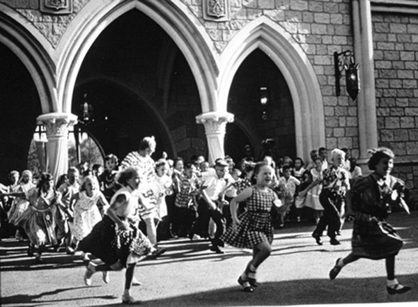 Children run through the Disneyland grounds on opening day, July 17, 1955.