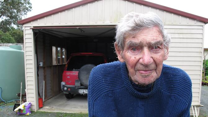 In this Sunday, May 26, 2013 photo, New Zealand's oldest driver Bob Edwards stands in front of his red Mitsubishi in Ngataki, New Zealand. Edwards, 105 years-old, got his first license 88 years ago and has no plans to stop driving. (AP Photo/Nick Perry)