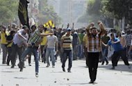 Supporters of deposed President Mohamed Mursi and the Muslim Brotherhood clash with anti-Mursi protesters during a march in Shubra street in Cairo October 4, 2013. REUTERS/ Mohamed Abd El Ghany
