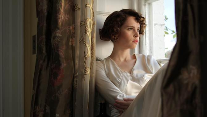 "This film image released by IFC Films shows Felicity Jones as Dolly Thatchum in a scene from ""Cheerful Weather for the Wedding."" (AP Photo/IFC Films, Julian White )"