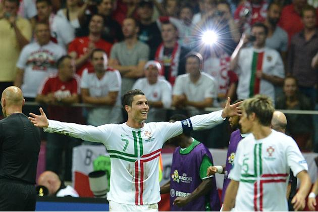 Portuguese Forward Cristiano Ronaldo (C) Celebrates AFP/Getty Images