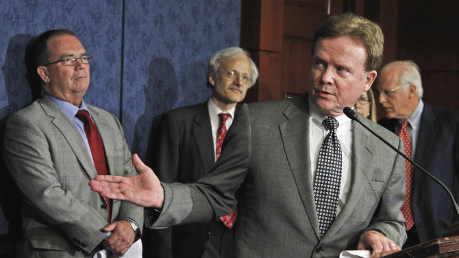 Sen. Jim Webb, D-Va., accompanied by the congressionally chartered Commission on Wartime Contracting in Iraq and Afghanistan Co-Chairs Michael Thibault, left, and former Connecticut Rep. Christopher Shays, right, gestures during the commission's  news conference on Capitol Hill in Washington, Wednesday, Aug. 31, 2011, to present a final report that summarizes more than two and a half years' work on waste and fraud in contracting.  Commission member Charles Tiefer is second from left. (AP Photo/Manuel Balce Ceneta)