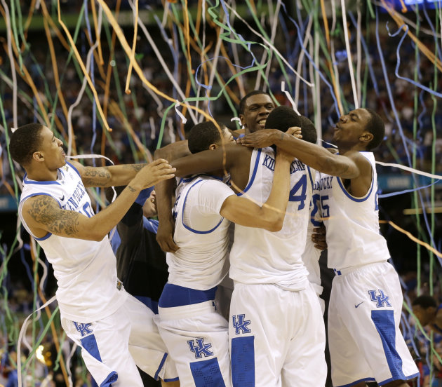 Kentucky players celebrate at the end of the NCAA Final Four tournament college basketball championship game against Kansas Monday, April 2, 2012, in New Orleans. Kentucky won 67-59. (AP Photo/David J
