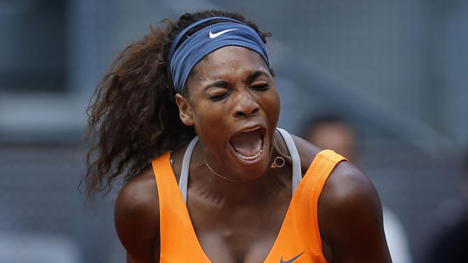 Serena Williams from U.S. celebrates a point against Anabel Medina from Spain during the Madrid Open tennis tournament, in Madrid,  Friday, May 10, 2013. (AP Photo/Daniel Ochoa de Olza)