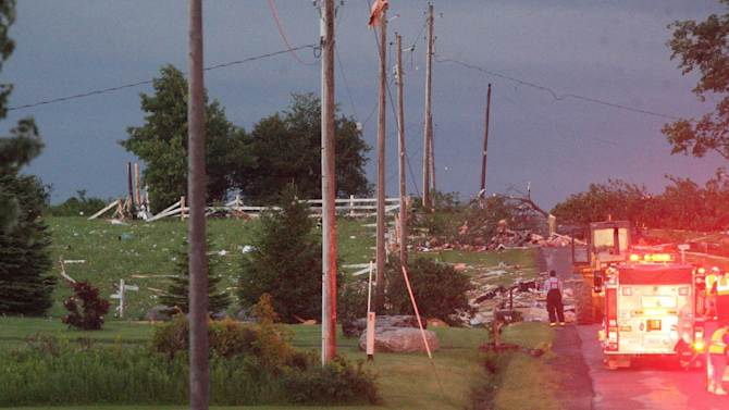 Debris is visible at Goff Road in Smithfield, N.Y., following severe storm on Tuesday