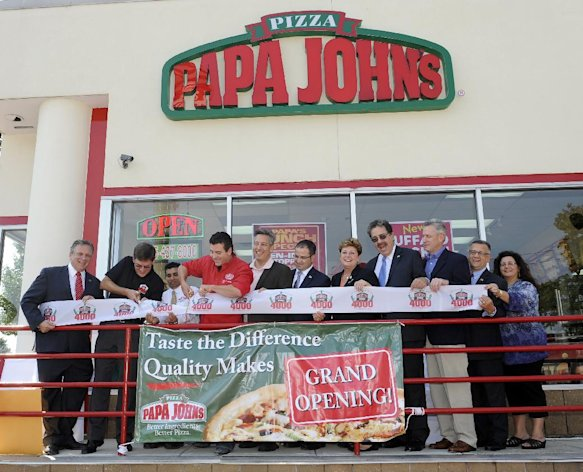 John Schnatter, red shirt, Founder, Chairman and CEO of Papa John&#39;s International, Inc., cuts the ribbon for the opening of his 4000th restaurant on Friday Sept. 14, 2012, in New Hyde Park, N.Y. l-r: Nassau County Executive Edward Mangano (red tie), Executive Vice President of Papa John&#39;s Anthony Thompson, New Hyde Park franchise owner Peter Mehta, John Schnatter, Town of North Hempstead Supervisor Jon Kaimen, NY Assemblyman Ed Ra, Town of North Hempstead Town Clerk Leslie Gross, President of the New Hyde Park Chamber of Commerce Mark Laytin, Nassau County Legislator Richard Nicolello, Secretary of the New Hyde Park Chamber of Commerce Jerry Badassaro and First Vice President of the New Hyde Park Chamber of Commerce Jeannette Frisina. (Photo by Kathy Kmonicek/Invision for Papa John&#39;s/AP Images)
