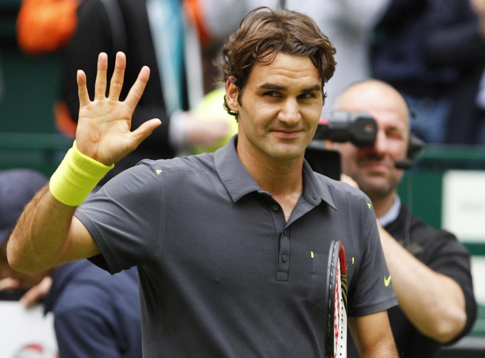 Switzerland 's  Roger Federer  reacts  after his  semifinal match against Mikhail Youzhny  from Russia at the Gerry Weber Open ATP  tennis tournament in Halle, western Germany, Saturday June 16, 2012.  Federer won by 6-1 and 6-3. (AP Photo/dapd/Joerg Sarbach)