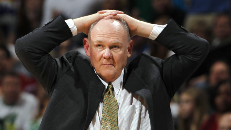 FILE - In this March 17, 2012 file photo, Denver Nuggets coach George Karl puts his hands on his head during an NBA game against the Boston Celtics in Denver. Karl is out as coach of the Nuggets. Team President Josh Kroenke confirmed in an email to The Associated Press on Thursday, June 6, 2013 that Karl's tenure was over just weeks after he was named the NBA's coach of the year. (AP Photo/David Zalubowsk, Filei)