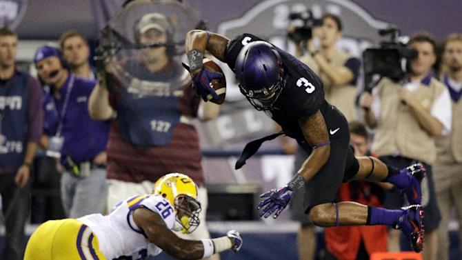 TCU wide receiver Brandon Carter (3) jumps against LSU safety Ronald Martin (26) after a reception during the first half of an NCAA college football game Saturday, Aug. 31, 2013, in Arlington, Texas. (AP Photo/LM Otero)