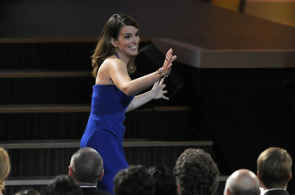 "Tina Fey reacts after it was announced she won the award for outstanding writing for a comedy series for ""30 Rock"" at the 65th Primetime Emmy Awards at Nokia Theatre on Sunday Sept. 22, 2013, in Los Angeles. (Photo by Chris Pizzello/Invision/AP)"