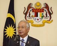 Why Malaysia's Mr Populist is risking wrath, tightening the purse