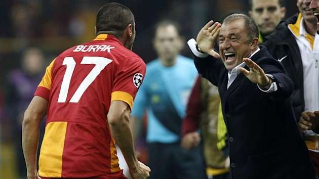 Galatasaray's Burak Yilmaz celebrates with his coach Fatih Terim (R) (Reuters)
