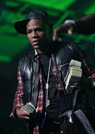 Floyd Mayweather throws cash on stage with 50 Cent at the Bud Light Hotel concert.