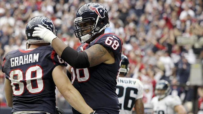 Houston Texans' Ryan Harris (68) congratulates Garrett Graham (88) on a touchdown against the Jacksonville Jaguars during the fourth quarter of an NFL football game, Sunday, Nov. 18, 2012, in Houston. (AP Photo/Patric Schneider)