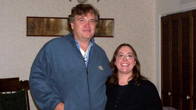 """This undated photo provided by Casper College shows professors Jim Krumm and Heidi Arnold, the couple killed by Krumm's adult son Chris Krumm on Friday, Nov. 30, 2012. Christopher Krumm, who police say killed his father, his father's girlfriend, and himself, had said weeks before that he believed his father gave him Asperger's syndrome and his dad should be """"castrated"""" to prevent him from having more children. Neighbor Matt DiPinto says Christopher Krumm made the comments while giving him a ride home a few weeks ago.(AP Photo/Casper College)"""