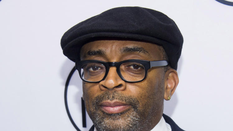 """FILE - In this June 10, 2013 file photo, Spike Lee attends the eighth annual Made in New York Awards in New York. Lee has launched a Kickstarter campaign to help fund his next feature film. The Brooklyn director on Monday unveiled his bid to raise $1.25 million over the next month. Lee offered few details on the film, but said it would be about """"the addiction of blood."""" (Photo by Charles Sykes/Invision/AP, File)"""
