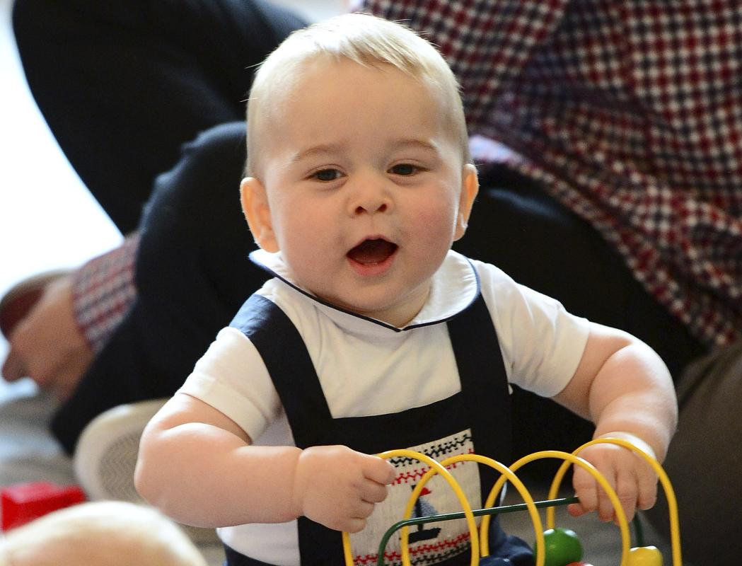 Britain's Prince George plays with a toy at a Plunket play group event at Government House in Wellington