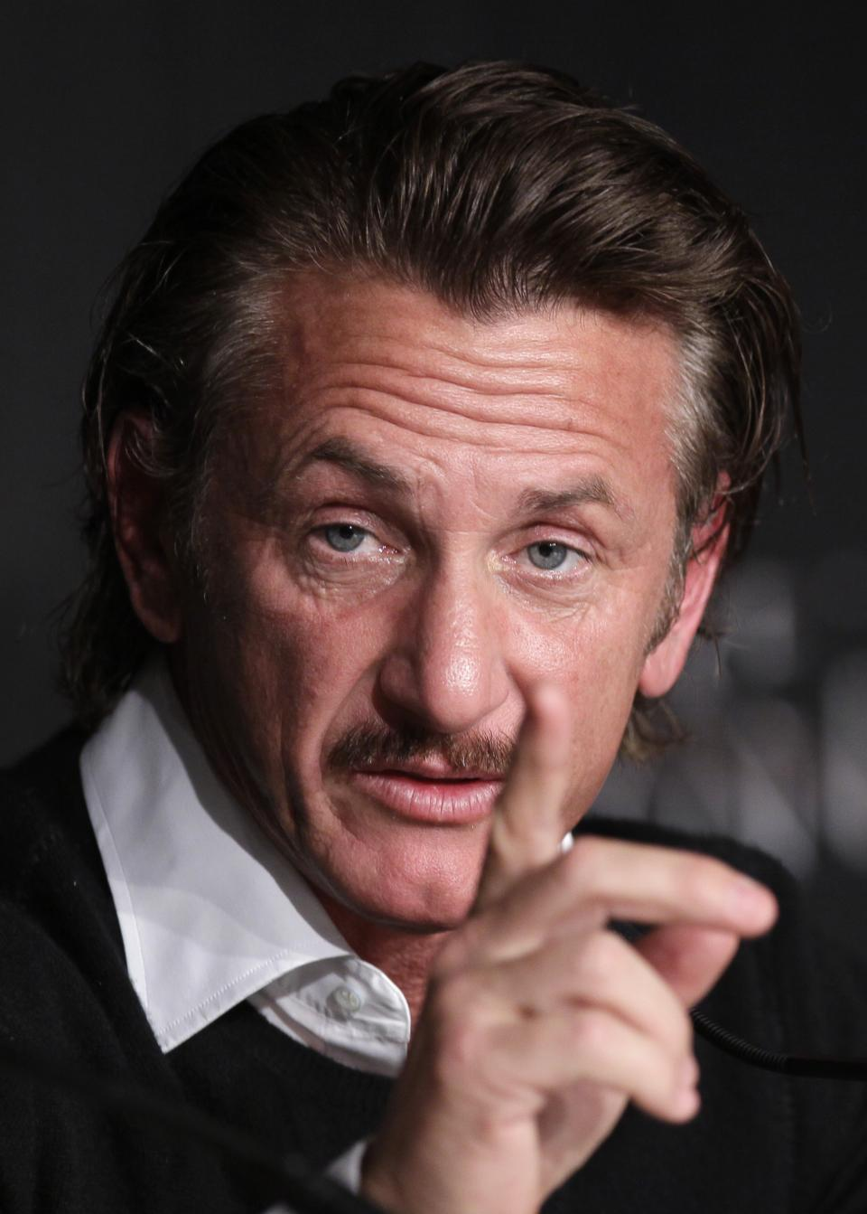 Actor Sean Penn gestures during a press conference for the Haiti Carnival charity event at the 65th international film festival, in Cannes, southern France, Friday, May 18, 2012. (AP Photo/Francois Mori)