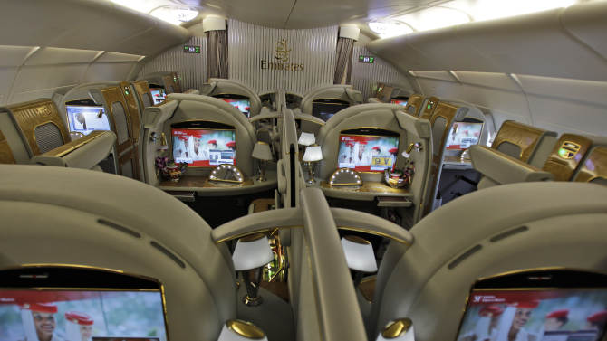 In this Sunday, Feb. 10, 2013, photo the first class section of an Emirates airlines Airbus A380 is ready for boarding at the new Concourse A of Dubai airport in Dubai, United Arab Emirates. For generations, international fliers have stopped over in London, Paris and Amsterdam. Now, they increasingly switch planes in Dubai, Doha and Abu Dhabi, making this region the new crossroads of global travel. The switch is driven by both the airports and airlines, all backed by governments that see aviation as the way to make their countries bigger players in the global economy. (AP Photo/Kamran Jebreili)