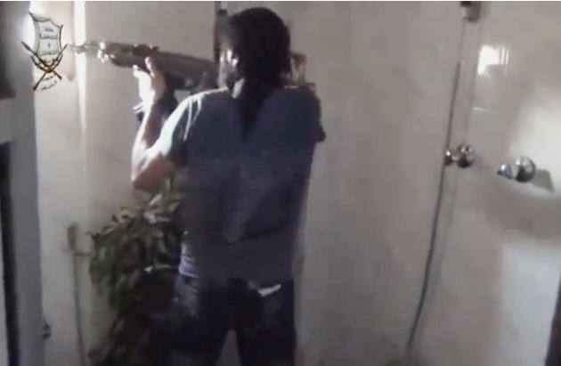 This image made from amateur video released by Ugarit News, which has been authenticated based on its contents and other AP reporting, shows a Syrian rebel firing his weapon in Damascus, Syria, Friday