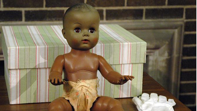 This photo provided by the National Park Service shows a black doll used in a series of famous race experiments on a table at the Brown v. Board of Education National Historic Site in Topeka, Kan. The doll, which was given to the site last year, will be displayed Friday, May 17, 2013, on the 59th  anniversary of the U.S. Supreme Court ruling that ended legal segregation in public schools. (AP Photo/Natioinal Park Service)