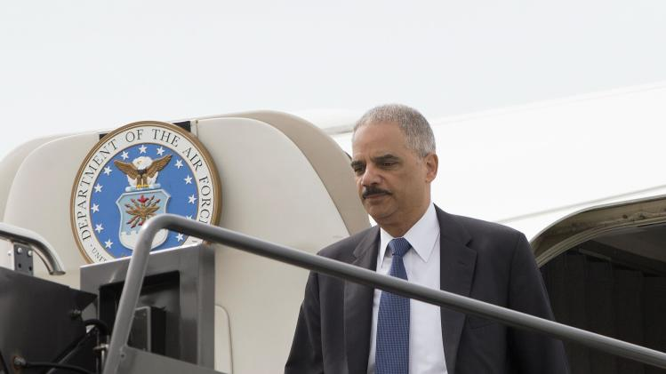 U.S. Attorney General Eric Holder steps off a U.S. military aircraft as he arrives at Lambert-St. Louis International Airport