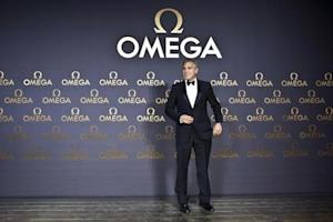 Director and actor George Clooney arrives at Omega's dinner party in Shanghai