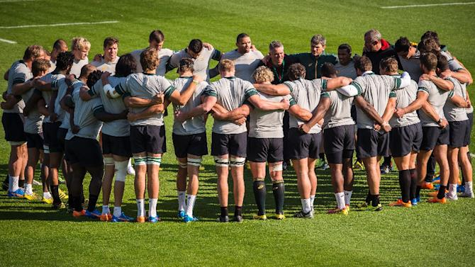 South Africas players huddle together during a training session at the Pennyhill park hotel in Bagshot on October 12, 2015