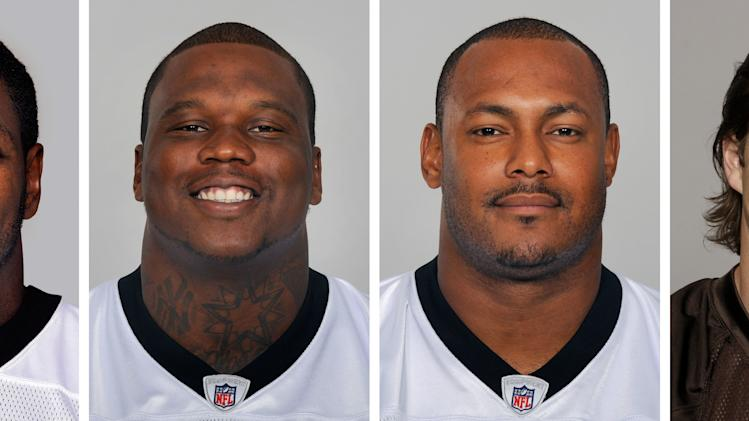 FILE - From left are NFL football players Jonathan Vilma, in 2011; Anthony Hargrove, in 2010; Will Smith, in 2011; and Scott Fujita, in 2011. The appeals hearing for four players suspended by NFL Commissioner Roger Goodell for their role in the Saints bounty program has begun. On hand at NFL headquarters Monday, June 18, 2012  are all four players: Saints linebacker Jonathan Vilma, who is suspended for the 2012 season; Green Bay defensive end Anthony Hargrove, suspended for eight games; defensive end Will Smith, who has been docked for four games; and Cleveland linebacker Scott Fujita (three games). (AP Photo/File)