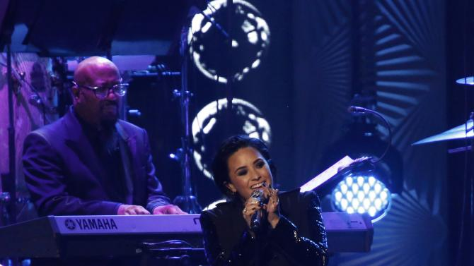 """Singer Demi Lovato performs """"Penny Lover"""" at the 2016 MusiCares Person of the Year gala in Los Angeles"""
