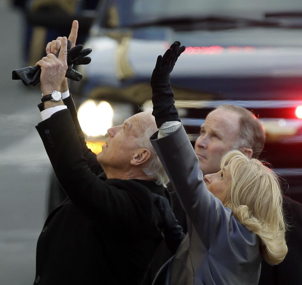 Vice President Joe Biden, left, and his wife, Jill, wave to people as they walk down Pennsylvania Avenue en route to the White House, Monday, Jan. 21, 2013, in Washington. Thousands  marched during the 57th Presidential Inauguration parade after the ceremonial swearing-in of President Barack Obama. (AP Photo/Steve Helber)