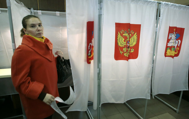 A woman votes at a polling station in the town of Khimki outside Moscow, Russia, Sunday, Oct. 14, 2012. Russians are casting ballots in local elections that offer a degree of political competition but still remain tightly controlled by President Vladimir Putin&#39;s government. One of the most visible races Sunday is that for mayor of the town of Khimki, just outside Moscow. (AP Photo/Mikhail Metzel)