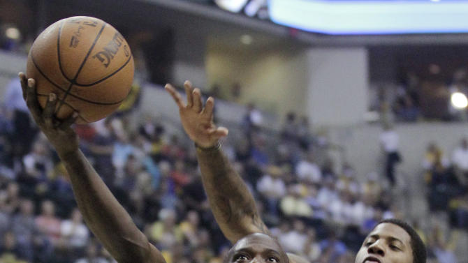 Orlando Magic guard Jason Richardson, left, shoots in front of Indiana Pacers guard Paul George in the first half of Game 5 of an NBA basketball first-round playoff series, in Indianapolis on Tuesday, May 8, 2012. (AP Photo/Michael Conroy)