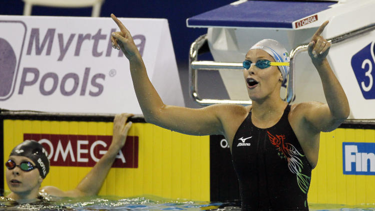 Italy's Federica Pellegrini celebrates after winning the women's 400m Freestyle final, at the FINA Swimming World Championships in Shanghai, China, Sunday, July 24, 2011. (AP Photo/Eugene Hoshiko)
