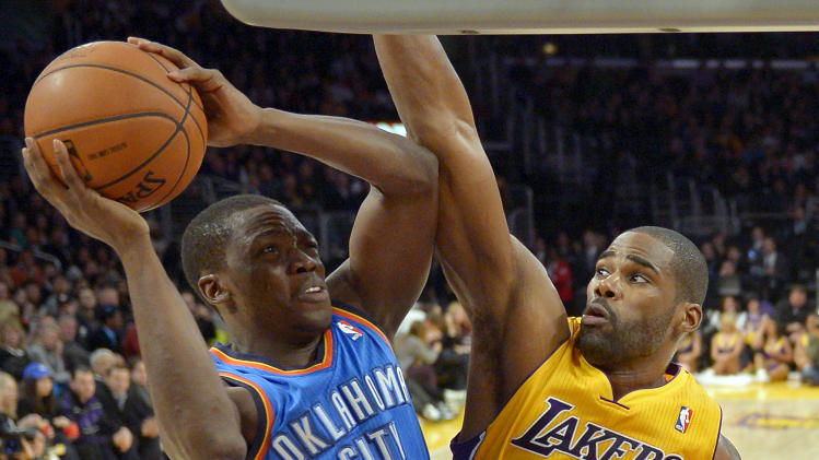 Oklahoma City Thunder guard Reggie Jackson, left, puts up a shot as Los Angeles Lakers forward Antawn Jamison defends during the first half of their NBA basketball game, Friday, Jan. 11, 2013, in Los Angeles. (AP Photo/Mark J. Terrill)