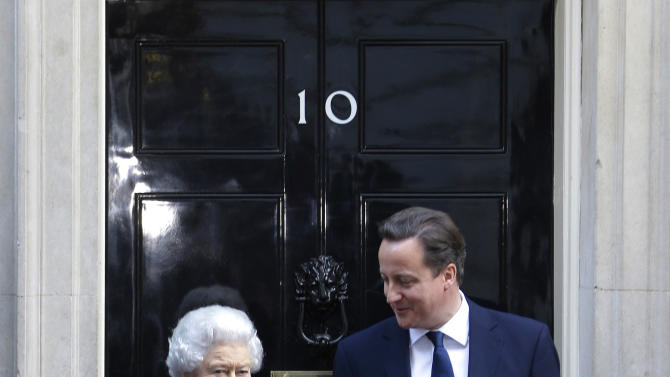 Britain's Prime Minister David Cameron, right, poses for photographers as he greets Britain's Queen Elizabeth II at his official residence at 10 Downing Street in central London, Tuesday, Dec. 18, 2012. The Queen was visiting Downing Street to attend the cabinet as an observer. (AP Photo/Lefteris Pitarakis)