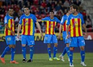 Levante's Wellington Alves da Silva (L) and his teammates during a Spanish league football match in May. Scottish side Motherwell face Spain's Levante, who are competing in Europe for the first time on Thursday