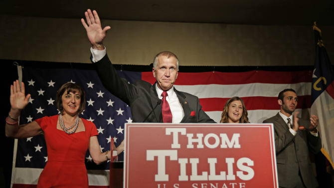 Thom Tillis waves to supporters as he celebrates