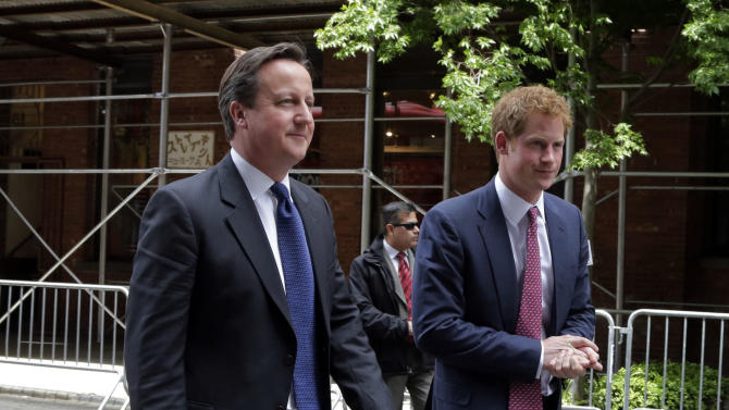 Britain's Prince Harry, right, and Prime Minister David Cameron arrive by New London Bus for the GREAT event, in New York, Tuesday, May 14, 2013.  They are in New York  to promote British trade and tourism.   (AP Photo/Richard Drew)