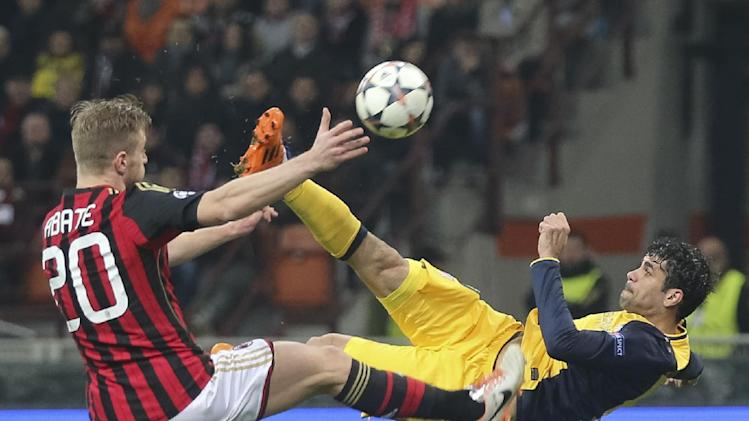 Atletico Madrid Brazilian forward Diego Costa, right, tries an acrobatic shot as AC Milan defender Ignazio Abate tries to stop him during a Champions League, round of 16, first leg, soccer match between AC Milan and Atletico Madrid at the San Siro stadium in Milan, Italy, Wednesday, Feb. 19, 2014