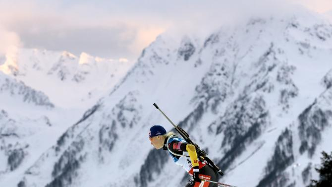 Winner of this event, Germany relay team member Miriam Gossner competes during the women's 4X6 km Relay at the Laura biathlon stadium in the Olympic mountain cluster during the IBU World Cup Biathlon in Sochi, Russia, Sunday, March 10, 2013. (AP Photo/Mikhail Metzel)