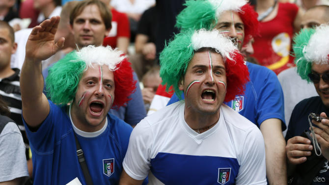 Supporters of Italy's national team cheer prior to the Euro 2012 soccer championship Group C match between  Spain and Italy in Gdansk, Poland, Sunday, June 10, 2012. (AP Photo/Michael Sohn)