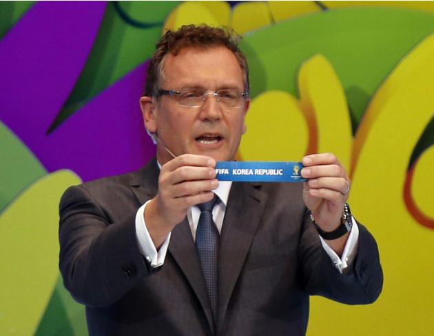 "FIFA Secretary General Jerome Valcke holds the slip showing ""South Korea"" during the draw for the 2014 World Cup at the Costa do Sauipe resort in Sao Joao da Mata"