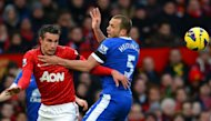 Everton&#39;s Dutch defender John Heitinga (R) tangles with Manchester United&#39;s Dutch striker Robin van Persie (L) during the English Premier League football match between Manchester United and Everton at Old Trafford, Manchester, North West England, on February 10, 2013. United won 2-0